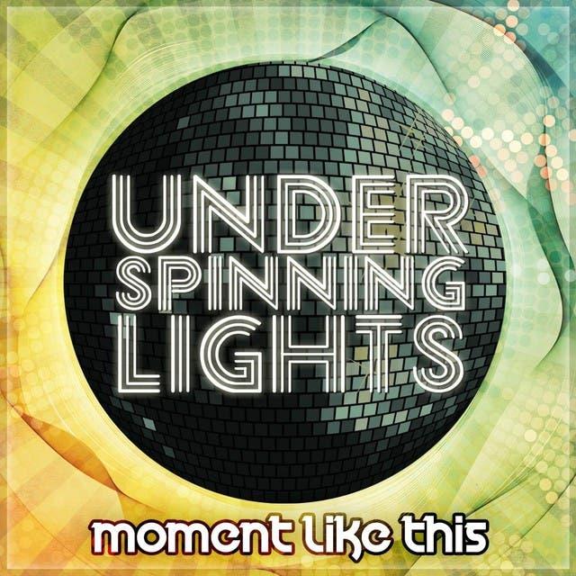 Under Spinning Lights image