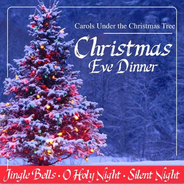 Christmas Eve Dinner. Carols Under The Christmas Tree